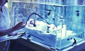 Paediatric nurse monitors baby