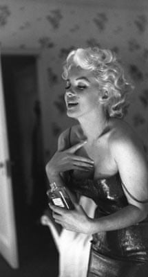 Marilyn Monroe getting ready for bed