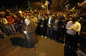Port Said clashes: People pray near Port Said stadium at Ramses metro station in Cairo