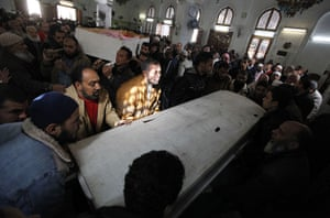 Port Said clashes: Mourners carry the bodies of victims of soccer violence in Port Said