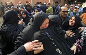 Port Said clashes: Egyptian women mourn at a morgue in Cairo