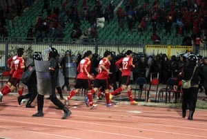 Port Said clashes: El-Ahly football players leave the the pitch at the Port Said stadium