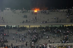 Port Said clashes: Fans start a fire at Cairo International Stadium in protest