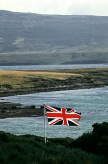 A union flag flies from a British war cemetery overlooking San Carlos Water, Falkland Islands.