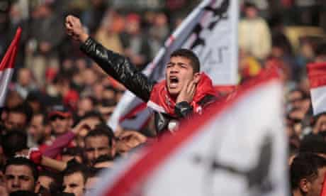 An Egyptian football fan protests in Cairo after the deaths of 74 people in Port Said