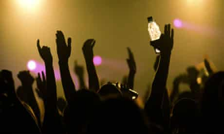 Crowd of clubbers dancing at a nightclub