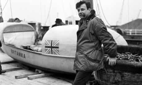 John Fairfax and his rowboat Britannia at King George V Dock, London, in 1969.
