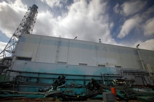 inside Fukushima: upturned trucks lie around the no.4 reactor