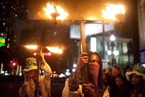 Mardi Gras: Flambeaus, or flame bearers