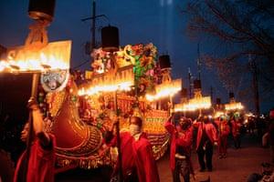 Mardi Gras: Fleambeaux Carriers march along side the Captain's float