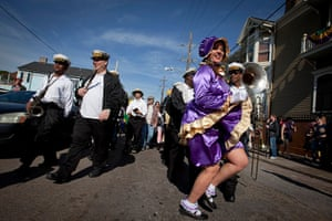 Mardi Gras: A participant dressed as a baby doll dances to the Treme Brass band