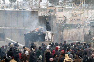 Bagram protest: a protester points towards a US soldier