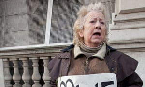 June Hautot protests outside Whitehall about changes to the NHS
