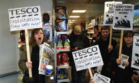 People occupy a Tesco store in Westminster in protest at the government's work experience scheme