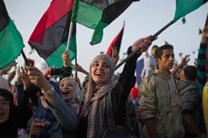 Remi Ochlik: Libyans celebrate following the official declaration of liberation