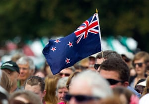 Christchurch memorial: A man holds a New Zealand flag
