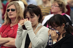 Christchurch memorial: People cry during Hagley Park memorial service