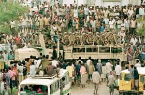 Somalia timeline: Mogadishu residents surround a truck carrying US marines