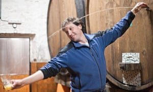 Decanting Spanish cider from the barrel