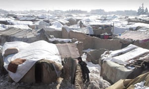 A displaced Afghan boy from Helmand province in a refugee camp in Kabul