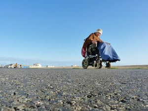 Weekend Readers Pictures: woman in an electric wheelchair by Pete Holmes
