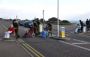 Weekend Readers Pictures: Army officers pushing wheelchairs near the seafront by Scott Sinclair