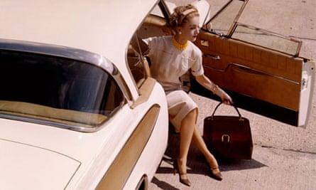 Woman in 1958 Packard Hawk car