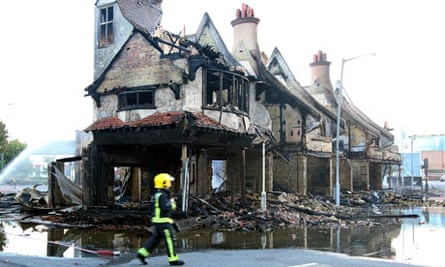 The shell of the Croydon furniture store after Gordon Thompson started a fire inside during UK riots