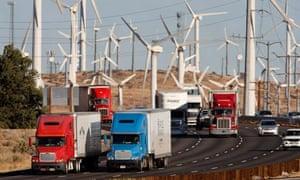 lorries infront of wind turbines