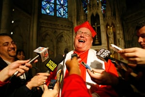 24hours: Cardinal Timothy Dolan laughs with reporters after holding a prayer service