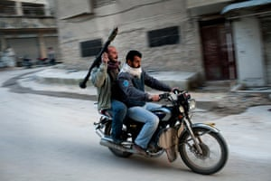 inside northern syria: Free Syrian Army fighters carry an RPG on a motorcycle in Kafar Taharim