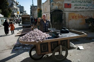 inside northern syria: A street vendor waits for customers in Kafar Taharim