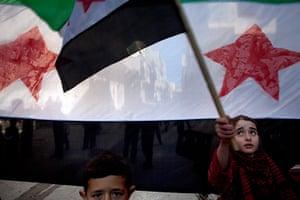 inside northern syria: Children attend a demonstration against Bashar Al-Assad's regime