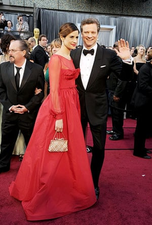 Oscars red carpet: Colin Firth in recycled Tom Ford, with Livia Giuggioli, in eco Valentino