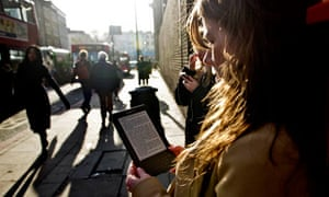 A woman reading on a Kindle