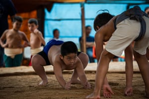 24 hours in pictures: A Brazilian boy during the under-18 Japanese Sumo wrestling tournament