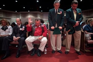 24 hours in pictures: Parishioners pray during a visit by Newt Gingrich