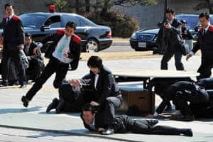 24 hours in pictures: A female presidential body guard shows her martial art skills, Seoul