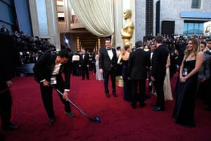 24 hours in pictures: Jason Segel watches an assistant vacuum the red carpet at the Oscars