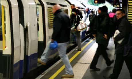 Passengers board a tube train