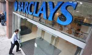 A customer walks into a Barclays bank high street branch
