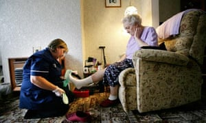 Elderly woman with social care assistant