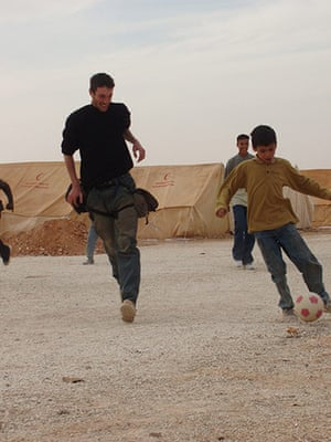 Tom Hurndall : Tom plays football with children