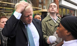 Boris Johnson is confronted during a visit to Peckham a week after the riots.