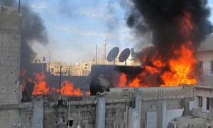 A fire on the roof of a building in the Baba Amr neighborhoud of the flashpoint city of Homs