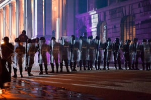 Guardian TV advert: Extras playing riot police line up outside Royal Naval College in Greenwich