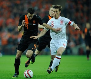 England  v Holland: Robin Van Persie is chased by Scott Parker