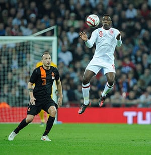 England v Holland: Danny Wellbeck controls the ball in front of Jonny Heitinga