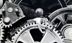 Charlie Chaplin parodies Ford's automated assembly line in Modern Times.