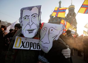 Russia Protest: Demonstrators wearing mock mask depicting Mikhail Prokhorov and Putin